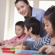 Teacher Helping Her Students — Stock Photo #36639227