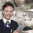 Stock Photo: Hostess in Industrial Kitchen