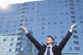 Businessman with arms raised — Stock Photo