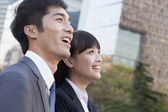 Business Colleagues Looking Away and Laughing — Stock Photo