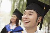 University Graduates Looking Away — Stock Photo