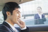 Businessman in Back Seat of Car on the Phone — Stock Photo