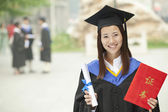 Happy Graduate with Diploma — Stock Photo