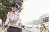 Business Woman commuting with a Bicycle — Stock Photo