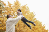 Father And Son Playing a Park in Autumn — Stock Photo