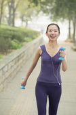 Woman exercise in the park — Stock Photo