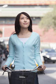 Young Woman on a Bicycle — Stock Photo