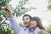 Couple Embracing and Pointing — Stock Photo