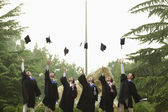 Group of University Graduates Throwing Mortarboards — Stock Photo