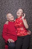 Senior Chinese Couple Laughing in Traditional Clothing — Stock Photo