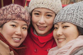 Three friends outdoors in winter — Stock Photo