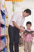 Father and Son Looking at a Book Together — Stock Photo