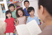 Teacher Reading to Her Students — 图库照片