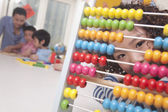 Little Girl Looking Through Abacus — Stock Photo
