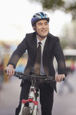 Businessman riding a bicycle — Stock Photo