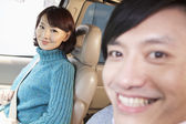 Couple sitting in car — Stock Photo