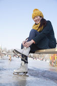 Woman Tying Ice Skates Outside — Stock Photo