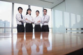 Business people standing by conference table — Stock Photo