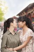 Young women embracing — Stock Photo