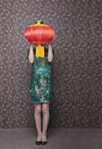 Woman covering her face with a Chinese lantern — Stock Photo