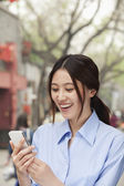Woman looking mobile phone — Stock Photo