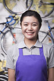Female mechanic in bicycle store — Stock Photo