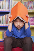 Unhappy Boy with Book — Stock Photo