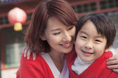 Mother and Son in Traditional Courtyard — Stock Photo
