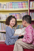 Boy and Girl Reading Together — Stock Photo