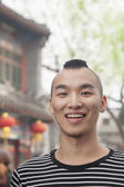Young Man with Mohawk haircut outdoors — Stock Photo