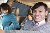 Family sitting in car — Stock Photo