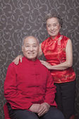 Senior couple in traditional Chinese clothing — Stock Photo