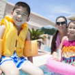 Family by the pool with pool toys — Stock Photo #36644027