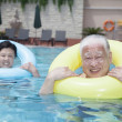 Senior couple relaxing in the pool — Stock Photo
