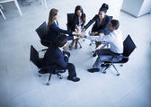 Business people sitting in a circle — Stock fotografie