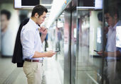 Businessman waiting for the subway — Stock Photo