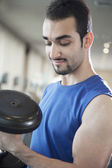 Muscular man lifting weights in the gym — Stock Photo