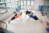 People stretching in an aerobics class — Stock Photo
