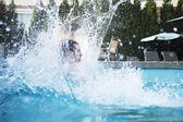 Man jumping into a pool — Foto Stock