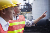 Engineers pointing outside of a factory — Stock Photo