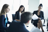 Business people sitting in a business meeting — Stock Photo