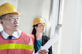 Architects in protective workwear — Stock Photo