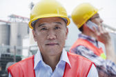 Two engineers in protective workwear working — Stock Photo