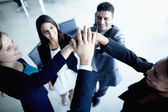 Business people cheering with hands together — Stock Photo