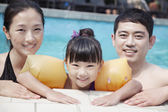 Family in the pool — Stock Photo