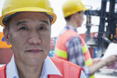 Engineers in protective workwear working — Stock Photo