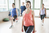 Four people stretching in aerobics class — Stok fotoğraf