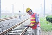 Railroad worker checking the railroad tracks — Stock Photo