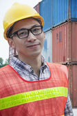 Engineer outdoors in a shipping yard — Stock Photo