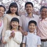 Family amongst the cherry trees — Stock Photo #36656745